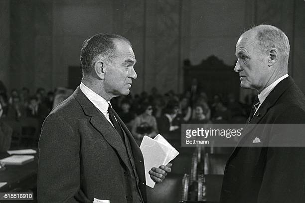 Senator J William Fulbright chairman of the Senate Foreign Relations Committee speaking to George Kennan in room of hearing