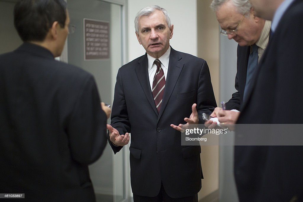 Senator <a gi-track='captionPersonalityLinkClicked' href=/galleries/search?phrase=Jack+Reed+-+Politician&family=editorial&specificpeople=534274 ng-click='$event.stopPropagation()'>Jack Reed</a>, a Democrat from Rhode Island, center, speaks to reporters after voting on the nomination of Janet Yellen as chairman of the U.S. Federal Reserve in Washington, D.C., U.S., on Monday, Jan. 6, 2014. Yellen, currently Fed vice chairman, won U.S. Senate confirmation to become the 15th chairman of the Federal Reserve and the first woman to head the central bank in its 100-year history. Photographer: Andrew Harrer/Bloomberg via Getty Images