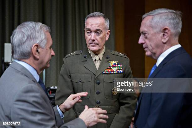 Senator Jack Reed a Democrat from Rhode Island left speaks with General Joseph Dunford chairman of the US Joint Chiefs of Staff center and James...