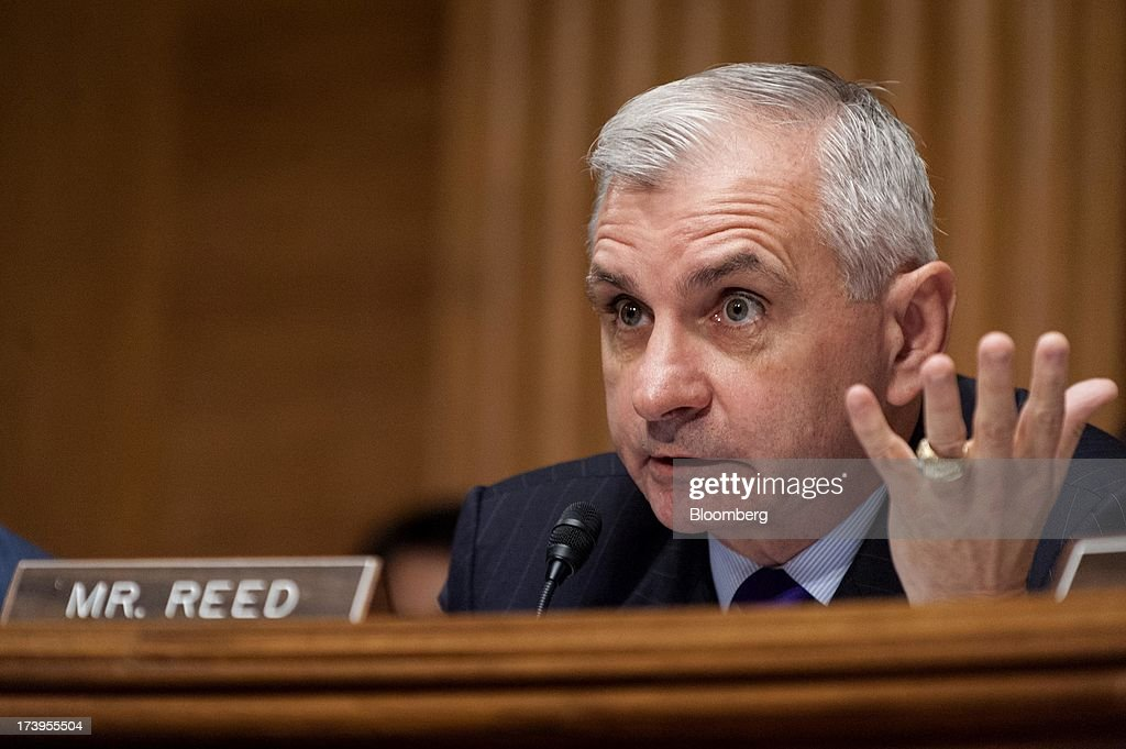 Senator Jack Reed, a Democrat from Rhode Island, questions Ben S. Bernanke, chairman of the U.S. Federal Reserve, not seen, during his semi-annual monetary policy report to the Senate Banking, Housing, and Urban Affairs Committee in Washington, D.C., U.S., on Thursday, July 18, 2013. Bernanke said one reason for the recent rise in long-term interest rates is the unwinding of leveraged and 'excessively risky' investing. Photographer: Pete Marovich/Bloomberg via Getty Images