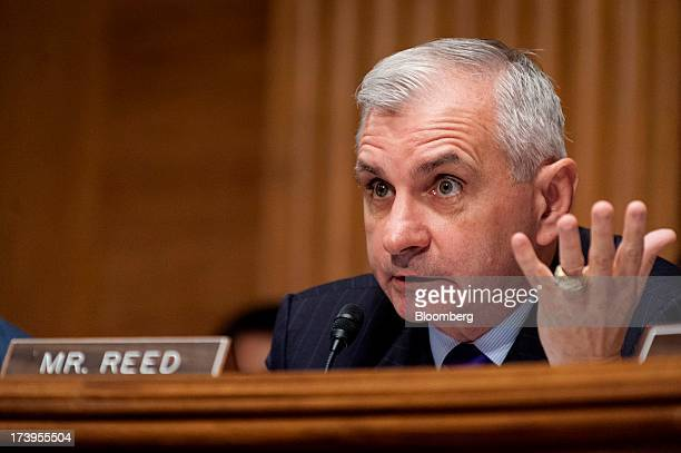 Senator Jack Reed a Democrat from Rhode Island questions Ben S Bernanke chairman of the US Federal Reserve not seen during his semiannual monetary...