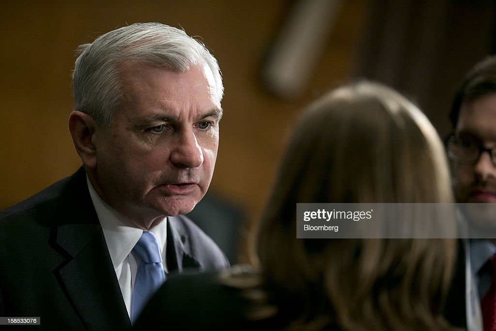 Senator Jack Reed, a Democrat from Rhode Island, speaks to reporters following a Senate Banking Committee hearing in Washington, D.C., U.S., on Tuesday, Dec. 18, 2012. NYSE Euronext and Nasdaq OMX Group Inc., their share of American equity markets squeezed by venues that sprang up in the mid-2000s, told legislators that too much trading occurs in dark pools, hurting investors. Photographer: Andrew Harrer/Bloomberg via Getty Images
