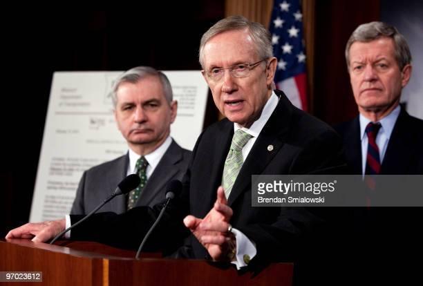 Senator Jack Reed and Senator Max Baucus listen to Senate Majority Leader Harry Reid speak during a press conference on Capitol Hill February 24 2010...