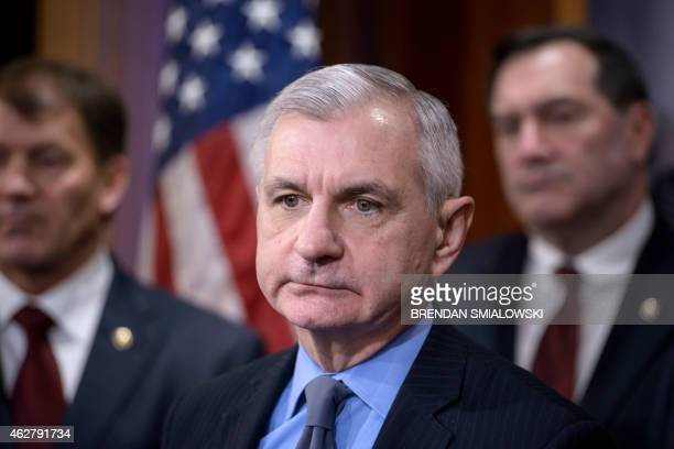 US Senator Jack Reed listens to questions during a press conference on Capitol Hill February 5 2015 in Washington DC The group of Senate Armed...