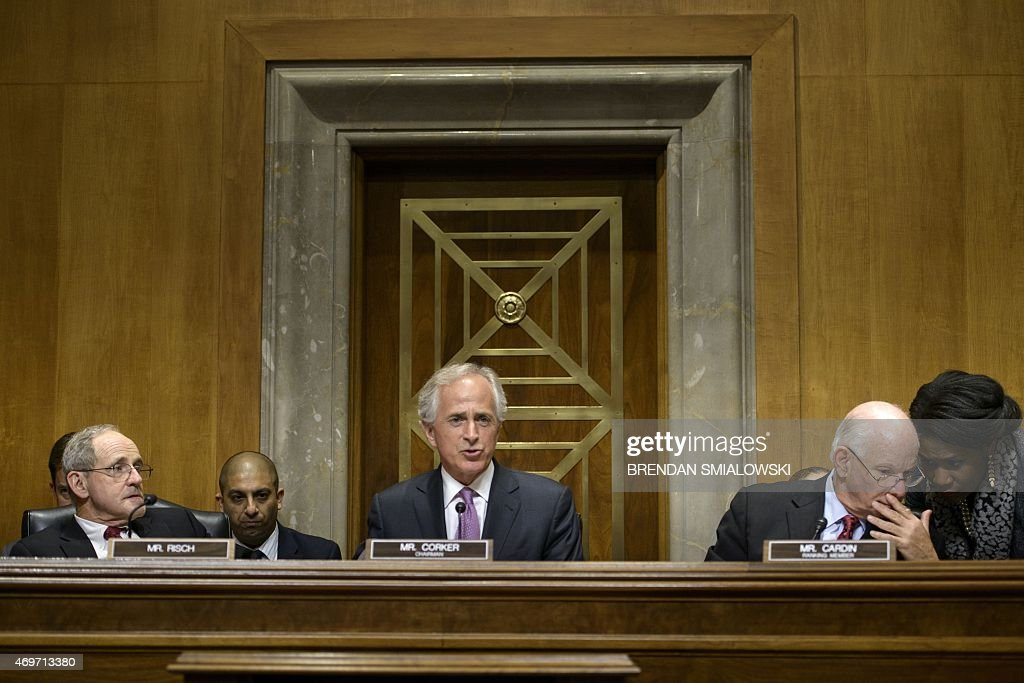 Senator James E. Risch(L) ,R-ID, and Senator Benjamin L. Cardin (R) D-MD, listen while committee chairman Senator <a gi-track='captionPersonalityLinkClicked' href=/galleries/search?phrase=Bob+Corker&family=editorial&specificpeople=3986296 ng-click='$event.stopPropagation()'>Bob Corker</a> ,R-TN, speaks during a meeting of the Senate Foreign Relations Committee on Capitol Hill April 14, 2015 in Washington, DC. The committee met to debate and vote on S.615, the Iran Nuclear Agreement Review Act of 2015.