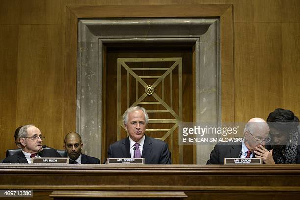 Senator James E Risch RID and Senator Benjamin L Cardin DMD listen while committee chairman Senator Bob Corker RTN speaks during a meeting of the...