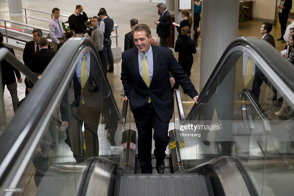 Senator <a gi-track='captionPersonalityLinkClicked' href=/galleries/search?phrase=Jeff+Flake&family=editorial&specificpeople=2474871 ng-click='$event.stopPropagation()'>Jeff Flake</a>, a Republican from Arizona, arrives to the U.S. Capitol to vote on the nomination of Janet Yellen as chairman of the U.S. Federal Reserve in Washington, D.C., U.S., on Monday, Jan. 6, 2014. Yellen, currently Fed vice chairman, won U.S. Senate confirmation to become the 15th chairman of the Federal Reserve and the first woman to head the central bank in its 100-year history. Photographer: Andrew Harrer/Bloomberg via Getty Images