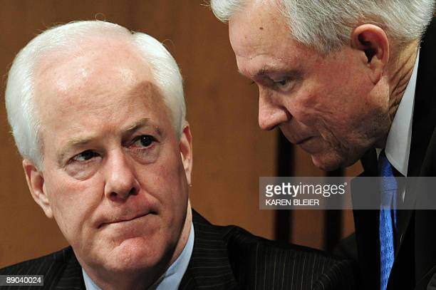 US Senator Jeff Sessions RAL speaks with Sen John CornynRTX as US Supreme Court Nominee Sonia Sotomayor answers questions on July 15 2009 during the...