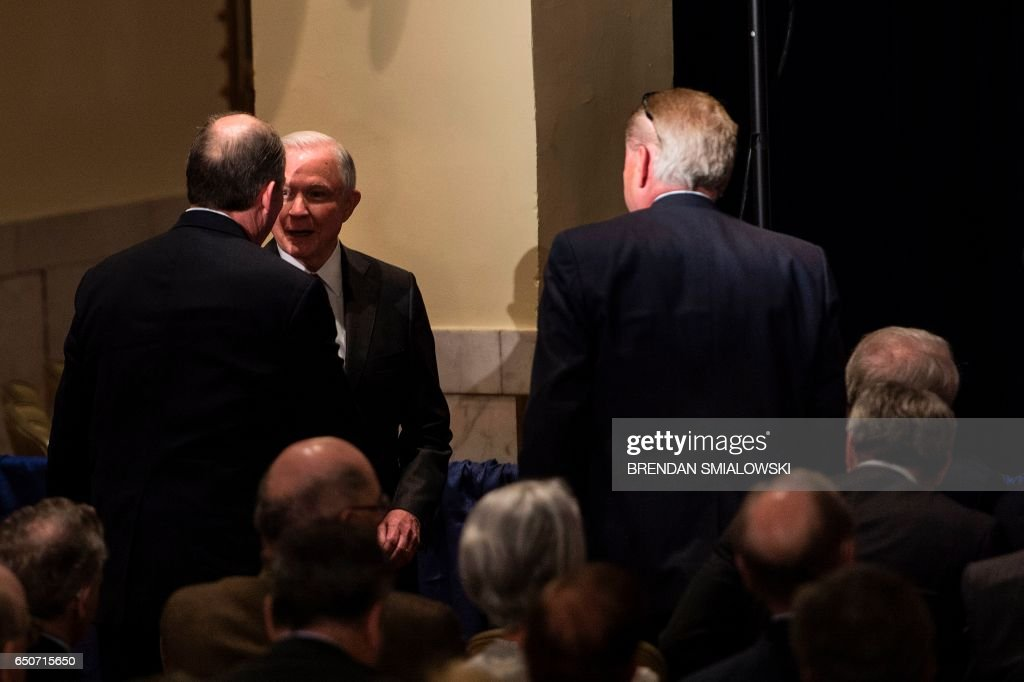 Senator Jeff Sessions (R-AL) (2L) speaks with a guest while Russian Ambassador to the US Sergey Kislyak (front row R) waits to hear Republican US Presidential hopeful Donald Trump speak about foreign policy at the Mayflower Hotel April 27, 2016 in Washington, DC. / AFP PHOTO / Brendan Smialowski