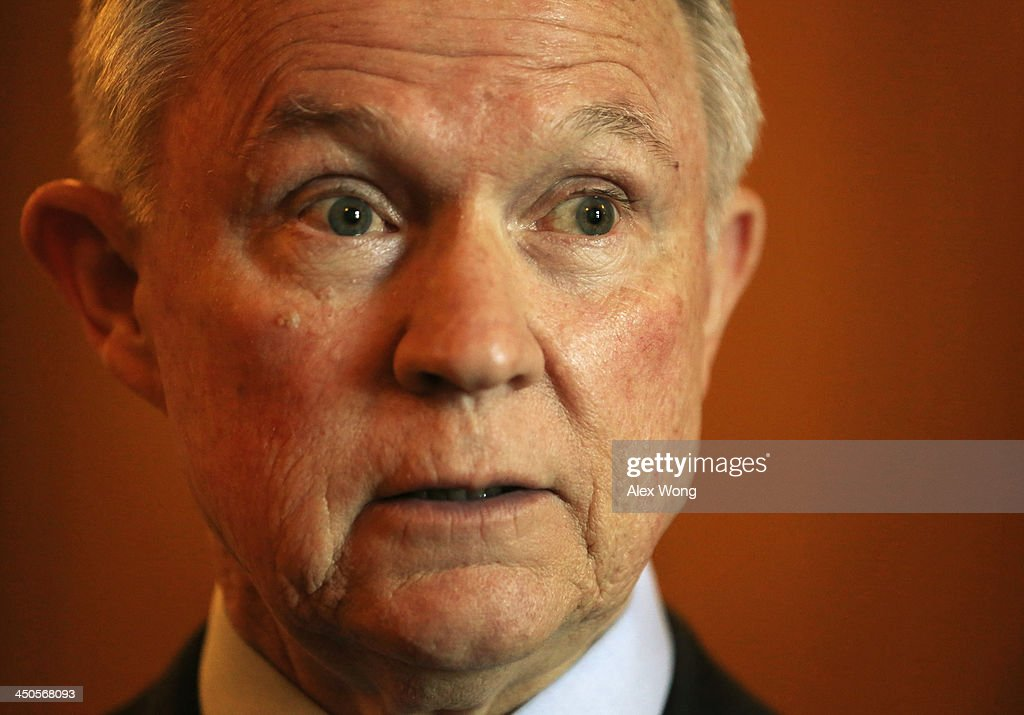 U.S. Senator <a gi-track='captionPersonalityLinkClicked' href=/galleries/search?phrase=Jeff+Sessions&family=editorial&specificpeople=534346 ng-click='$event.stopPropagation()'>Jeff Sessions</a> (R-AL) talks to reporters as he arrives at the Senate Republican weekly policy luncheon November 19, 2013 on Capitol Hill in Washington, DC. Senate Republicans participated in the luncheon to discuss Republican agendas.