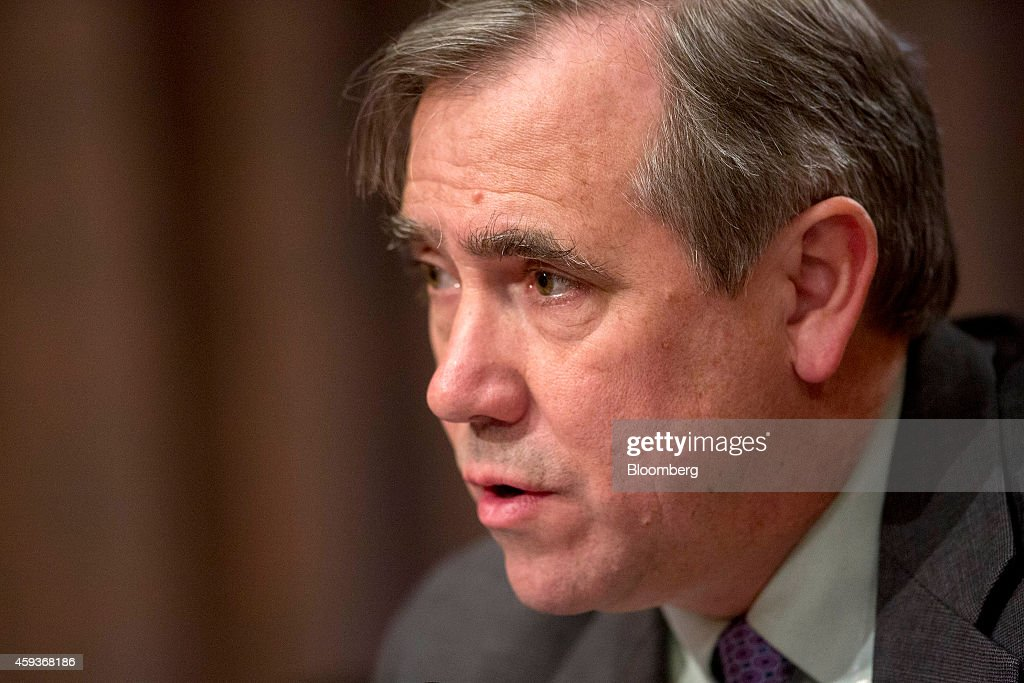 Senator Jeffrey 'Jeff' Merkley, a Democrat from Oregon, speaks during a a Senate Banking Subcommittee hearing with William C. Dudley, president and chief executive officer of the Federal Reserve Bank of New York, not pictured, in Washington, D.C., U.S., on Friday, Nov. 21, 2014. Dudley said in testimony he vowed to improve bank supervision and regulation, saying he's aware of the risk of becoming too cozy with large financial firms. Photographer: Andrew Harrer/Bloomberg via Getty Images
