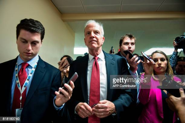 Senator Jerry Moran walks to a vote on Capitol Hill July 18 2017 in Washington DC Republicans control 52 of the chamber's 100 seats Democrats are...