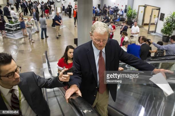 Senator Jim Inhofe a Republican from Oklahoma speaks to a member of the media near the Senate Subway in Washington DC US on Thursday July 27 2017...