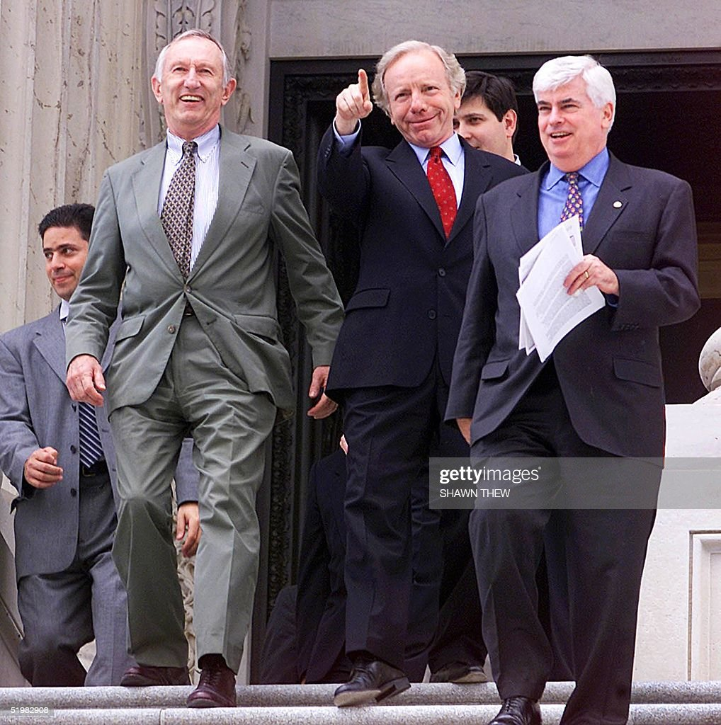 US Senator Jim Jeffords (L) (I-VT) leaves the US Capitol in Washington, DC, with Senators Joe Lieberman (C) (D-CT) and Christopher Dodd (D-CT) 05 June 2001 after attending a Democratic luncheon. Jeffords parting with the Republican Party gives the Democrats a 50-49 advantage in the Senate.