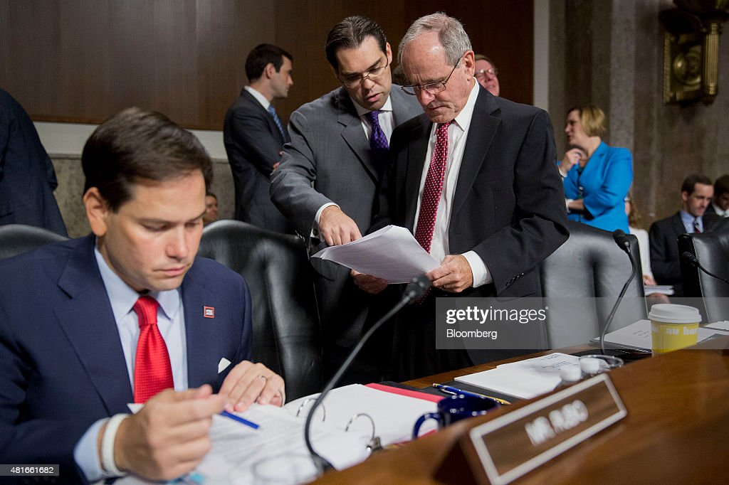 Senator <a gi-track='captionPersonalityLinkClicked' href=/galleries/search?phrase=Jim+Risch&family=editorial&specificpeople=5610137 ng-click='$event.stopPropagation()'>Jim Risch</a>, a Republican from Idaho, right, talks to an assistant before the start of a Senate Foreign Relations Committee hearing with Senator <a gi-track='captionPersonalityLinkClicked' href=/galleries/search?phrase=Marco+Rubio+-+Politician&family=editorial&specificpeople=11395287 ng-click='$event.stopPropagation()'>Marco Rubio</a>, a Republican from Florida and U.S. presidential candidate, left, in Washington, D.C., U.S., on Thursday, July 23, 2015. Senator Bob Corker, a key player in the congressional debate over the nuclear deal with Iran, told Secretary of State John Kerry that the Obama administration is engaging in hyperbole to sell it. Photographer: Andrew Harrer/Bloomberg via Getty Images