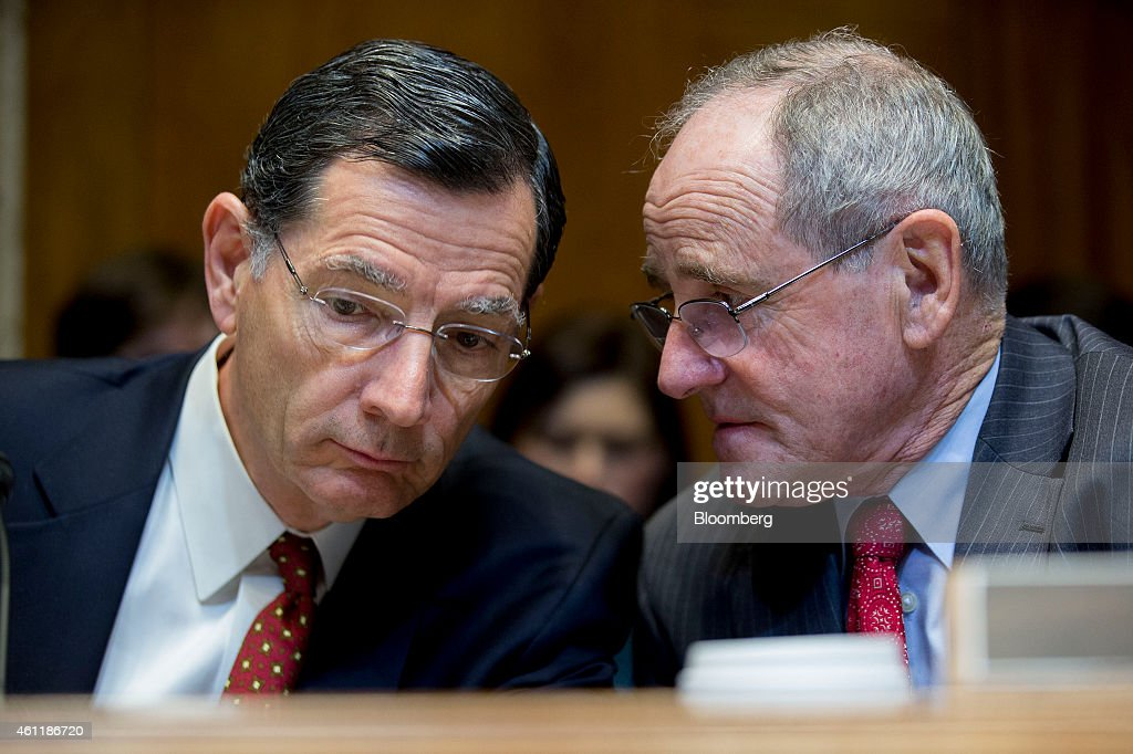 Senator <a gi-track='captionPersonalityLinkClicked' href=/galleries/search?phrase=Jim+Risch&family=editorial&specificpeople=5610137 ng-click='$event.stopPropagation()'>Jim Risch</a>, a Republican from Idaho, right, talks to Senator <a gi-track='captionPersonalityLinkClicked' href=/galleries/search?phrase=John+Barrasso&family=editorial&specificpeople=5312607 ng-click='$event.stopPropagation()'>John Barrasso</a>, a Republican from Wyoming, during a Senate Energy and Natural Resources Committee business meeting to markup an original bill to approve the Keystone XL pipeline in Washington, D.C., U.S., on Thursday, Jan. 8, 2015. Senate Majority Leader Mitch McConnell has vowed to make Keystone the first bill passed in 2015. House Speaker John Boehner also plans to push a bill. Photographer: Andrew Harrer/Bloomberg via Getty Images