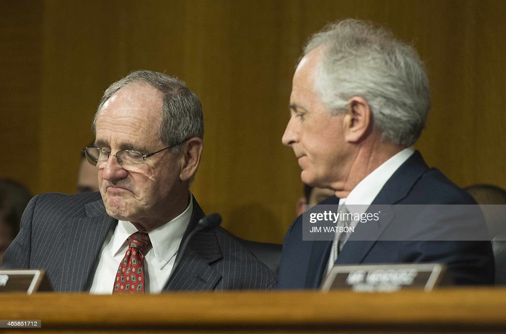 US Senator <a gi-track='captionPersonalityLinkClicked' href=/galleries/search?phrase=Jim+Risch&family=editorial&specificpeople=5610137 ng-click='$event.stopPropagation()'>Jim Risch</a> (L), R-Idaho, speaks with Chairman of the Senate Foreign Relations Committee Senator <a gi-track='captionPersonalityLinkClicked' href=/galleries/search?phrase=Bob+Corker&family=editorial&specificpeople=3986296 ng-click='$event.stopPropagation()'>Bob Corker</a> (R), R-Tennessee, during a Senate Foreign Relations Committee hearing in Washington, DC, March 11, 2015.
