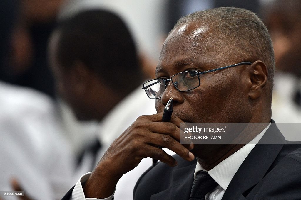 Senator Jocelerme Privert, candidate for the provisional presidency, listens as Haitian lawmakers prepare to elect an interim president February 13, 2016 in Port-au-Prince. Haitian lawmakers were set to elect an interim president to fill the power vacuum following the departure of Michel Martelly, after a vote to choose his replacement was postponed over fears of violence. / AFP / HECTOR RETAMAL