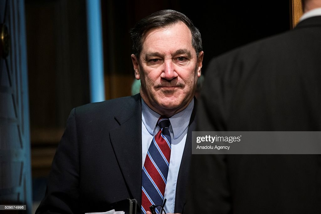Senator Joe Donnelly enters the chambers for a Senate Banking Committee on the semiannual monetary report to Congress hearing in Washington, USA on February 11, 2016.