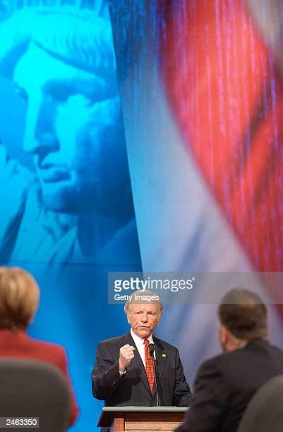 S Senator Joe Lieberman gestures as he addresses debate moderators Maria Lena Salinas and Ray Suarez at the Democratic Presidential Candidate Debate...