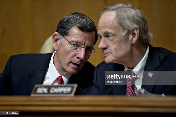 Senator John Barrasso a Republican from Wyoming and chairman of the Senate Environment and Public Works Committee left speaks to ranking member...