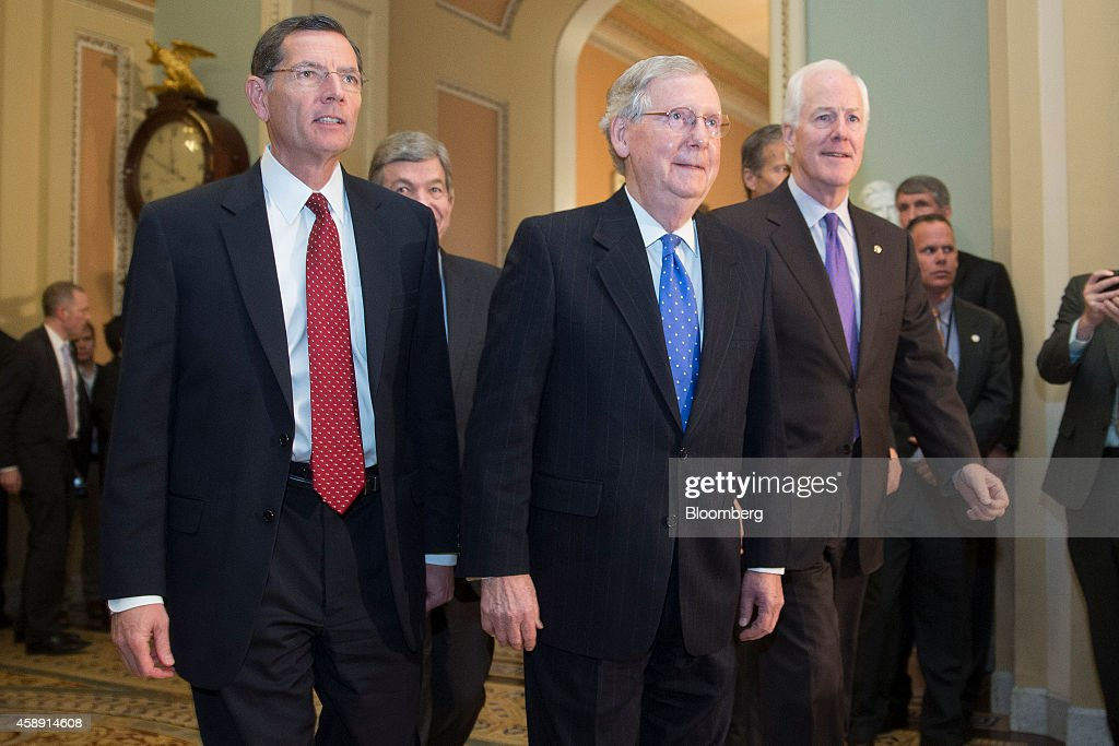 Senator <a gi-track='captionPersonalityLinkClicked' href=/galleries/search?phrase=John+Barrasso&family=editorial&specificpeople=5312607 ng-click='$event.stopPropagation()'>John Barrasso</a>, a Republican from Wyoming, from left, Senator <a gi-track='captionPersonalityLinkClicked' href=/galleries/search?phrase=Roy+Blunt&family=editorial&specificpeople=233679 ng-click='$event.stopPropagation()'>Roy Blunt</a>, a Republican from Missouri, Senate Minority Leader <a gi-track='captionPersonalityLinkClicked' href=/galleries/search?phrase=Mitch+McConnell&family=editorial&specificpeople=217985 ng-click='$event.stopPropagation()'>Mitch McConnell</a>, a Republican from Kentucky, and Senator <a gi-track='captionPersonalityLinkClicked' href=/galleries/search?phrase=John+Cornyn&family=editorial&specificpeople=154884 ng-click='$event.stopPropagation()'>John Cornyn</a>, a Republican from Texas, walk though the U.S. Capitol Building after holding a private meeting in Washington, D.C., U.S., on Thursday, Nov. 13, 2014. <a gi-track='captionPersonalityLinkClicked' href=/galleries/search?phrase=Mitch+McConnell&family=editorial&specificpeople=217985 ng-click='$event.stopPropagation()'>Mitch McConnell</a> was re-elected as Senate Republican leader, moving a step closer to realizing his ambition to be Senate majority leader when his party assumes control of the chamber in January. Photographer: Andrew Harrer/Bloomberg via Getty Images