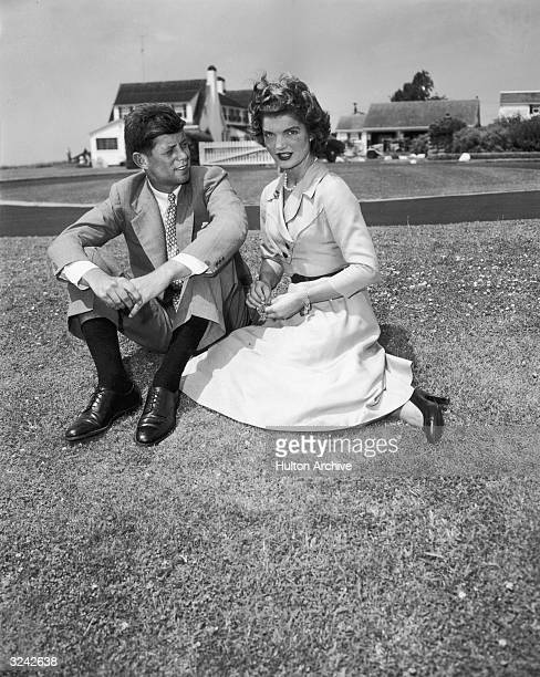 US senator John F Kennedy and his wife Jacqueline sit on the grass in front of their home Hyannis Massachusetts 1953 They had just married