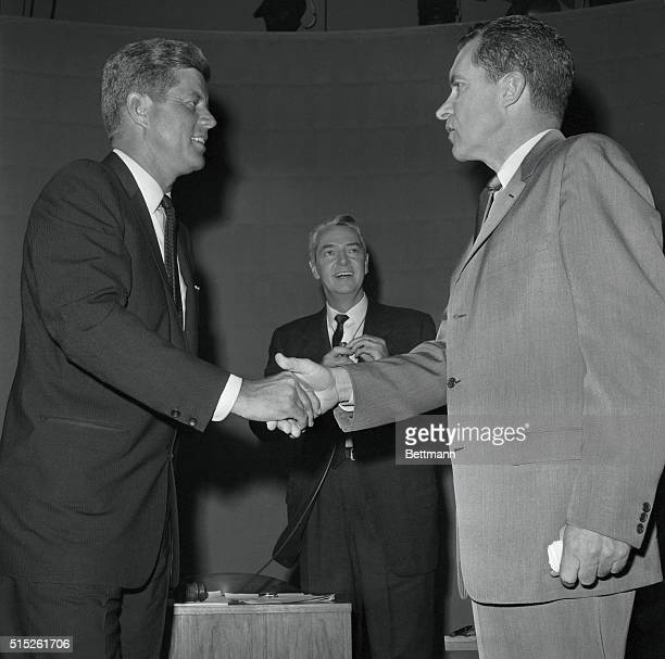 Senator John F Kennedy and Vice President Richard Nixon shake hands in TV studio here 9/26 after meeting in the first of their nationally televised...