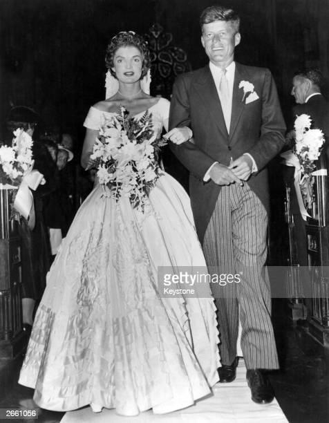 Senator John Fitzgerald Kennedy Democratic senator for Massachusetts escorts his bride Jacqueline Lee Bouvier down the church aisle shortly after...