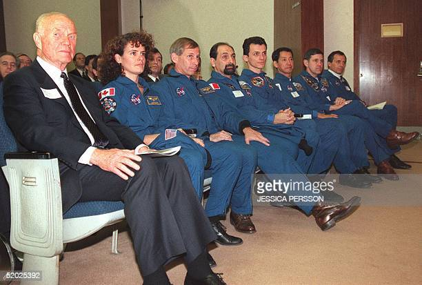 Senator John Glenn DOH sits with fellow astronaut Julie Payette of Canada and other astronauts representing Japan Russia and 11 European countries...