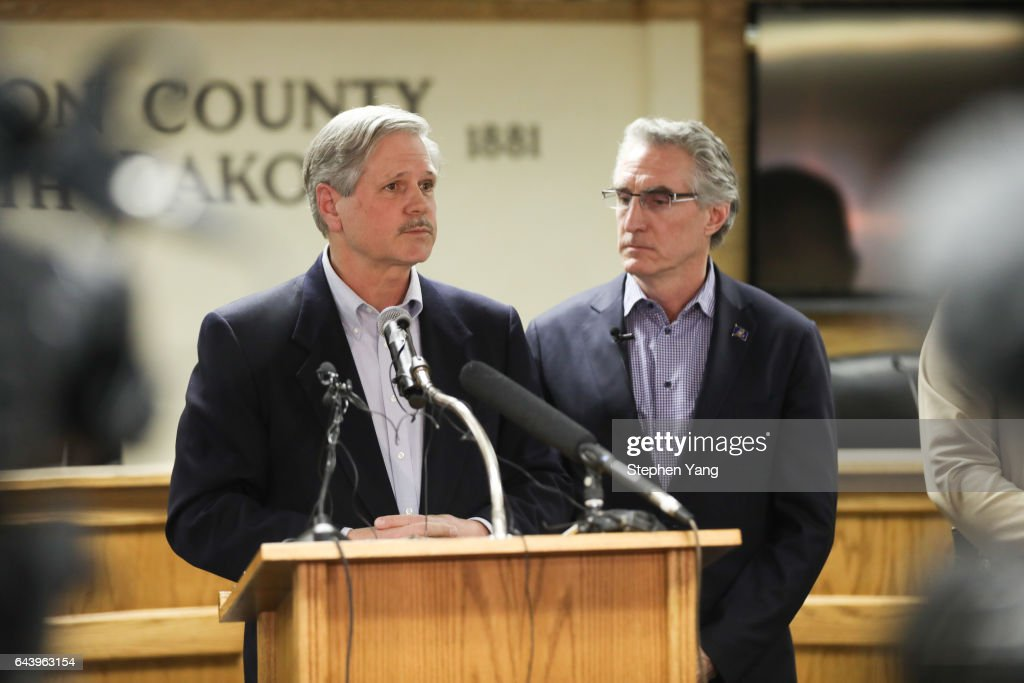 US Senator John Hoeven of North Dakota (L), and North Dakota Governor Doug Burgum holds a press conference announcing plans for the clean up of the Oceti Sakowin protest camp on February 22, 2017 in Mandan, North Dakota. Protesters and campers against the DAPL pipeline, at times numbering in the thousands, are now down to under a hundred.
