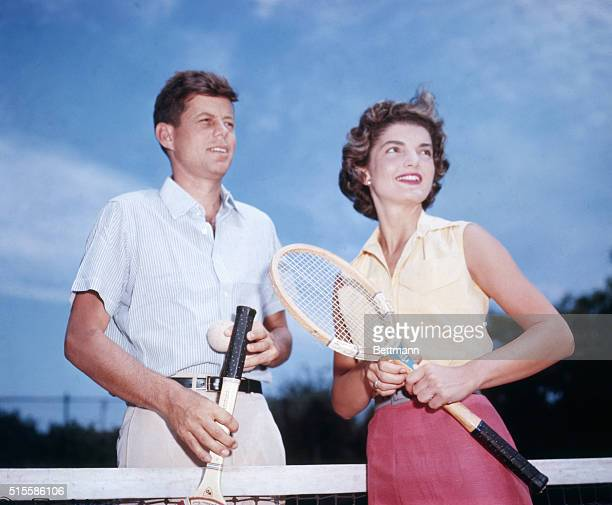 Senator John Kennedy and his fiancee Jacqueline Bouvier play tennis