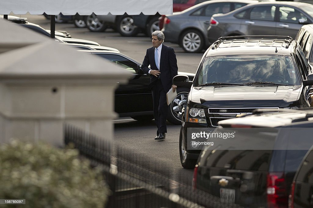 Senator John Kerry, a Democrat from Massachusetts, walks into the West Wing of the White House in Washington, D.C., U.S., on Friday, Dec. 28, 2012. President Barack Obama is set to propose a scaled-back package at a meeting with congressional leaders to avert tax and spending changes that could trigger a recession in 2013, a Democratic aide with knowledge of the talks said. Photographer: Andrew Harrer/Bloomberg via Getty Images