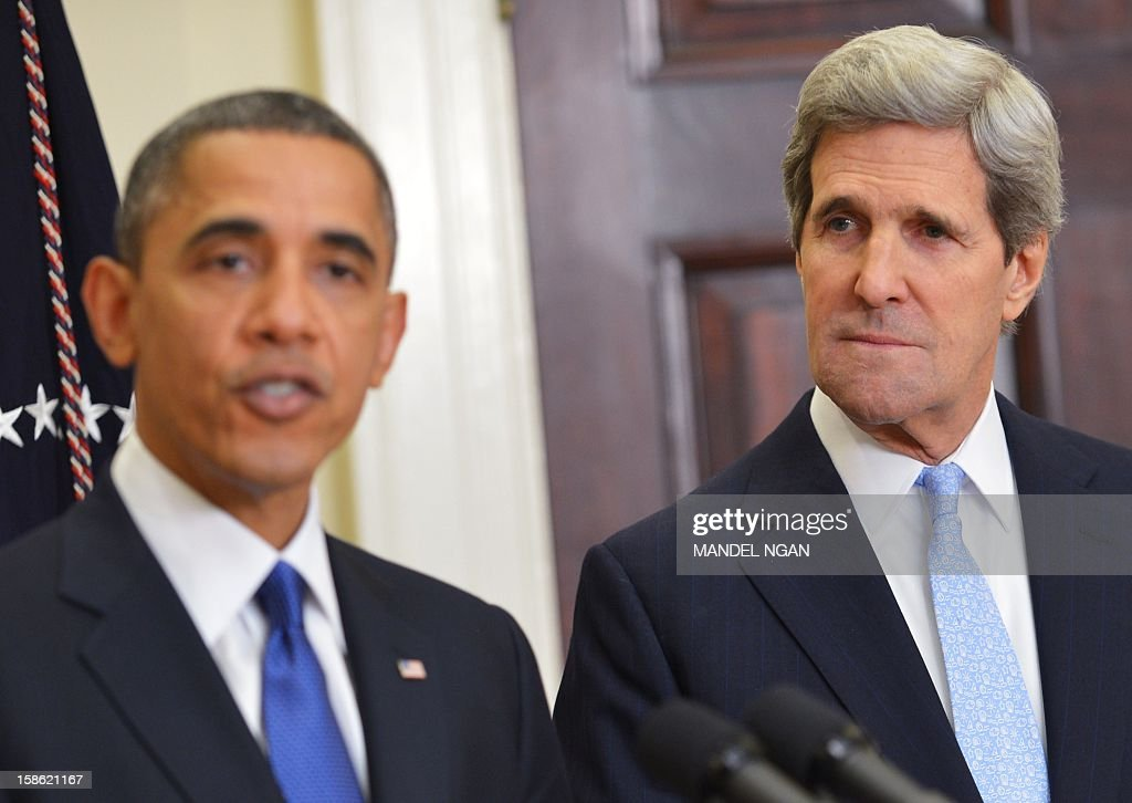 US Senator John Kerry D-MA (R) watches as US President <a gi-track='captionPersonalityLinkClicked' href=/galleries/search?phrase=Barack+Obama&family=editorial&specificpeople=203260 ng-click='$event.stopPropagation()'>Barack Obama</a> announces Kerry as his choice for the next secretary of state on December 21, 2012 in the Roosevelt Room of the White House in Washington, DC. AFP PHOTO/Mandel NGAN