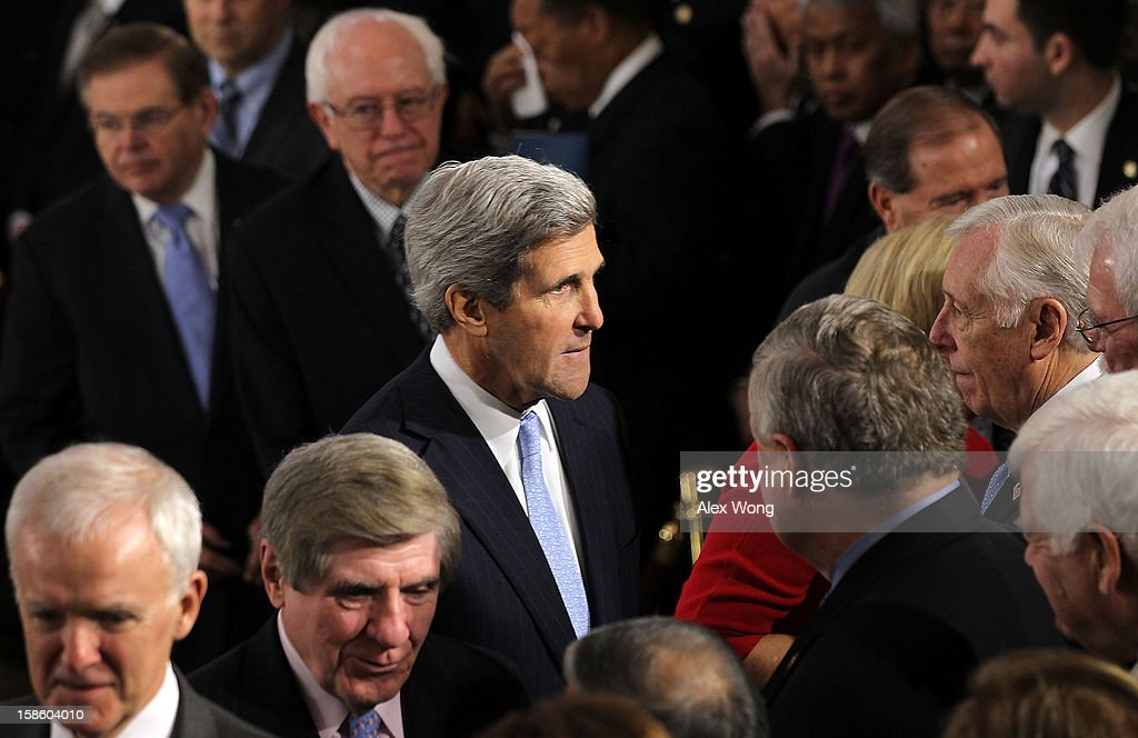 U.S. Senator <a gi-track='captionPersonalityLinkClicked' href=/galleries/search?phrase=John+Kerry&family=editorial&specificpeople=154885 ng-click='$event.stopPropagation()'>John Kerry</a> (D-MA) (C) greets House Minority Whip Rep. <a gi-track='captionPersonalityLinkClicked' href=/galleries/search?phrase=Steny+Hoyer&family=editorial&specificpeople=588093 ng-click='$event.stopPropagation()'>Steny Hoyer</a> (D-MD) (R) and other congressional members as he wait in-line to bid farewell to Senator Daniel Inouye (D-HI) who lies in state in the Rotunda of the U.S. Capitol during a service December 20, 2012 on Capitol Hill in Washington, DC. The late Senator had died at the age of 88 on Monday at the Walter Reed National Military Medical Center in Bethesda, Maryland where he had been hospitalized since early December. A public funeral service will be held at the Washington National Cathedral on Friday for Senator Inouye, a World War II veteran and the second-longest serving senator in history. His remains will be returned and laid to rest in his home state.