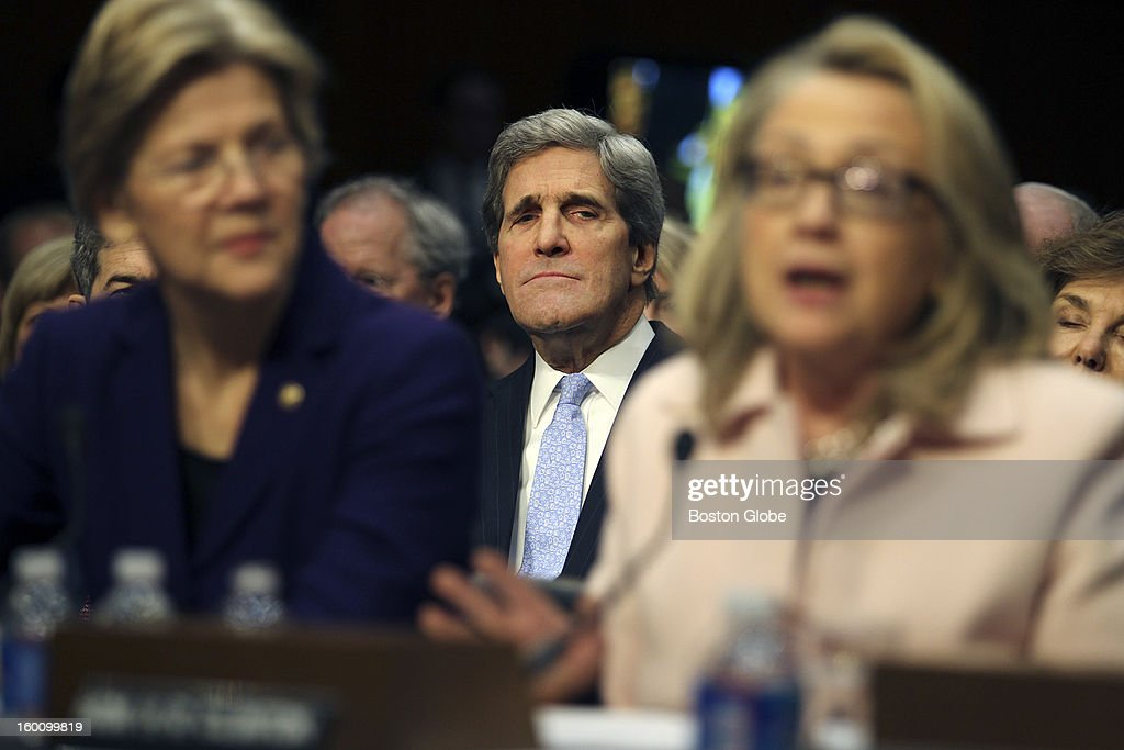 Senator John Kerry listens as he is introduced by Elizabeth Warren and Hillary Clinton before the Senate Foreign Relations Committee during his confirmation hearing to become Secretary of State. (Globe staff photo / Bill Greene) section: national, reporter:bender, topic: 25Kerry