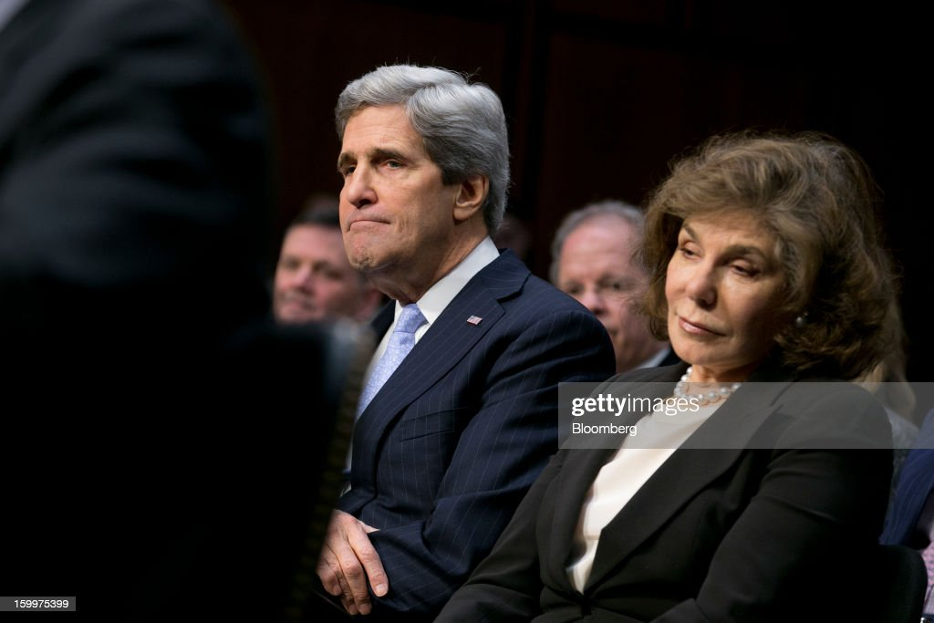 Senator <a gi-track='captionPersonalityLinkClicked' href=/galleries/search?phrase=John+Kerry&family=editorial&specificpeople=154885 ng-click='$event.stopPropagation()'>John Kerry</a>, nominee for U.S. Secretary of State and a Democrat from Massachusetts, left, and his wife <a gi-track='captionPersonalityLinkClicked' href=/galleries/search?phrase=Teresa+Heinz+Kerry&family=editorial&specificpeople=154895 ng-click='$event.stopPropagation()'>Teresa Heinz Kerry</a>, chairman of Heinz Family Philanthropies, listen during a Senate Foreign Relations Committee nomination hearing in Washington, D.C., U.S., on Thursday, Jan. 24, 2013. Kerry stressed the need to prevent Iran from acquiring nuclear weapons. He described the 'immediate, dangerous challenges' facing the nation as he seeks confirmation to become secretary of state. Photographer: Andrew Harrer/Bloomberg via Getty Images