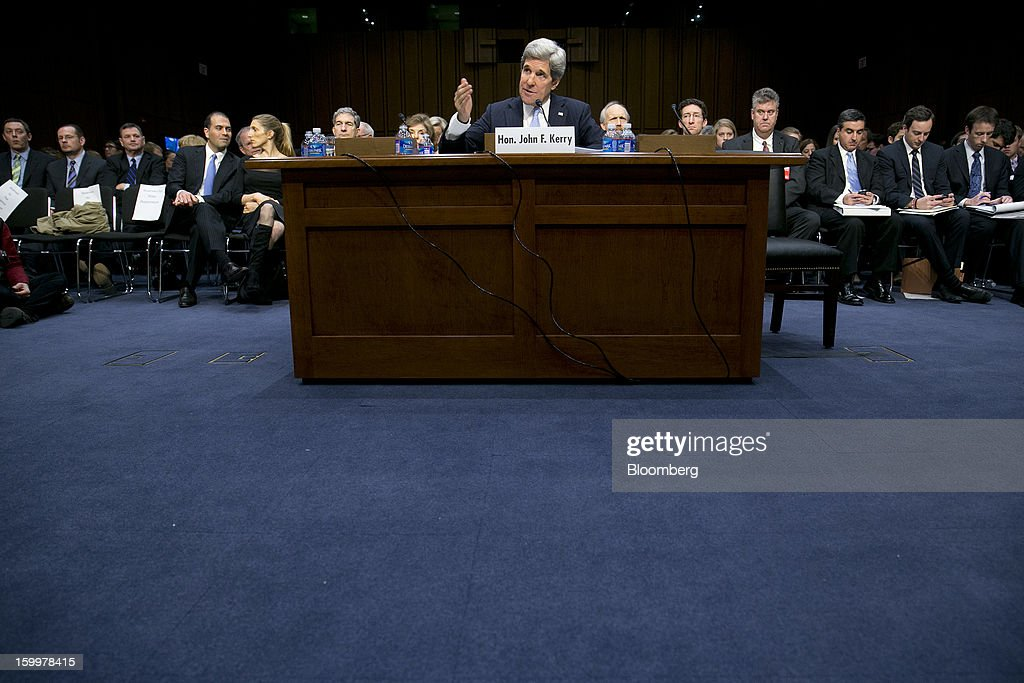 Senator <a gi-track='captionPersonalityLinkClicked' href=/galleries/search?phrase=John+Kerry&family=editorial&specificpeople=154885 ng-click='$event.stopPropagation()'>John Kerry</a>, nominee for U.S. Secretary of State and a Democrat from Massachusetts, speaks during a Senate Foreign Relations Committee hearing in Washington, D.C., U.S., on Thursday, Jan. 24, 2013. Kerry stressed the need to prevent Iran from acquiring nuclear weapons. He described the 'immediate, dangerous challenges' facing the nation as he seeks confirmation to become secretary of state. Photographer: Andrew Harrer/Bloomberg via Getty Images