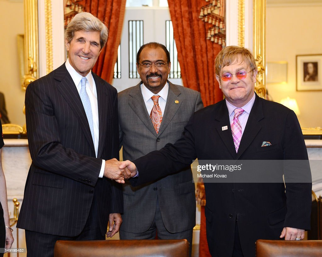 U.S. Senator John Kerry (D-MA), UNAIDS Executive Director Michel Sidibe, and Sir Elton John meet after The Elton John AIDS Foundation and UNAIDS breakfast at the Russell Senate Office Building on July 24, 2012 in Washington, DC.