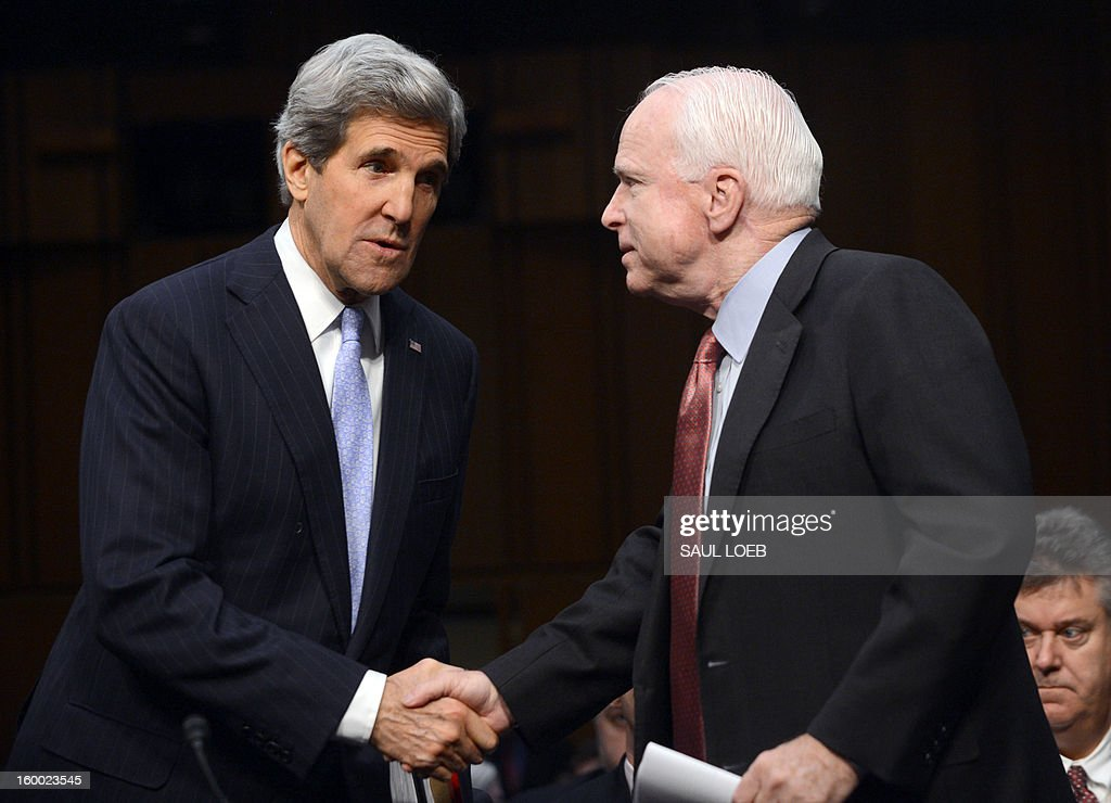US Senator John Kerry, US President Barack Obama's nominee for Secretary of State, greets Sen. John McCain,R-AZ, prior to giving testimony before the Senate Foreign Relations committee during his confirmation hearing on Capitol Hill in Washington, DC, on January 24, 2013. AFP PHOTO / Saul LOEB