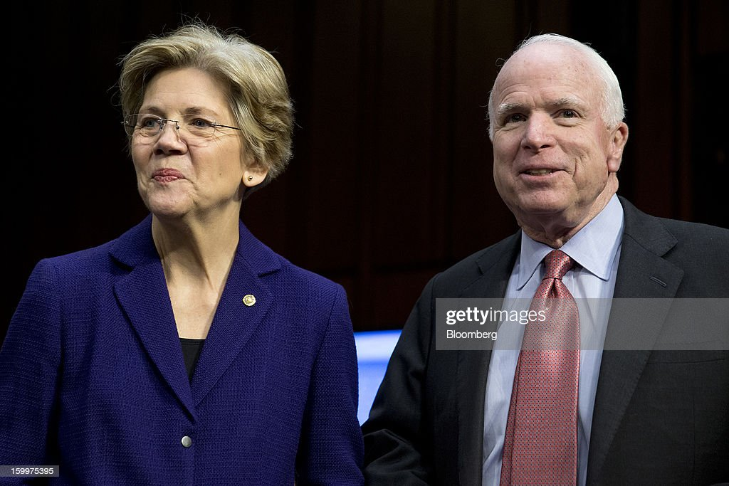 Senator <a gi-track='captionPersonalityLinkClicked' href=/galleries/search?phrase=John+McCain&family=editorial&specificpeople=125177 ng-click='$event.stopPropagation()'>John McCain</a>, a Republican from Arizona, right, and Senator <a gi-track='captionPersonalityLinkClicked' href=/galleries/search?phrase=Elizabeth+Warren&family=editorial&specificpeople=5396017 ng-click='$event.stopPropagation()'>Elizabeth Warren</a>, a Democrat from Massachusetts, talk prior to a Senate Foreign Relations Committee nomination hearing in Washington, D.C., U.S., on Thursday, Jan. 24, 2013. Senator John Kerry stressed the need to prevent Iran from acquiring nuclear weapons. He described the 'immediate, dangerous challenges' facing the nation as he seeks confirmation to become secretary of state. Photographer: Andrew Harrer/Bloomberg via Getty Images