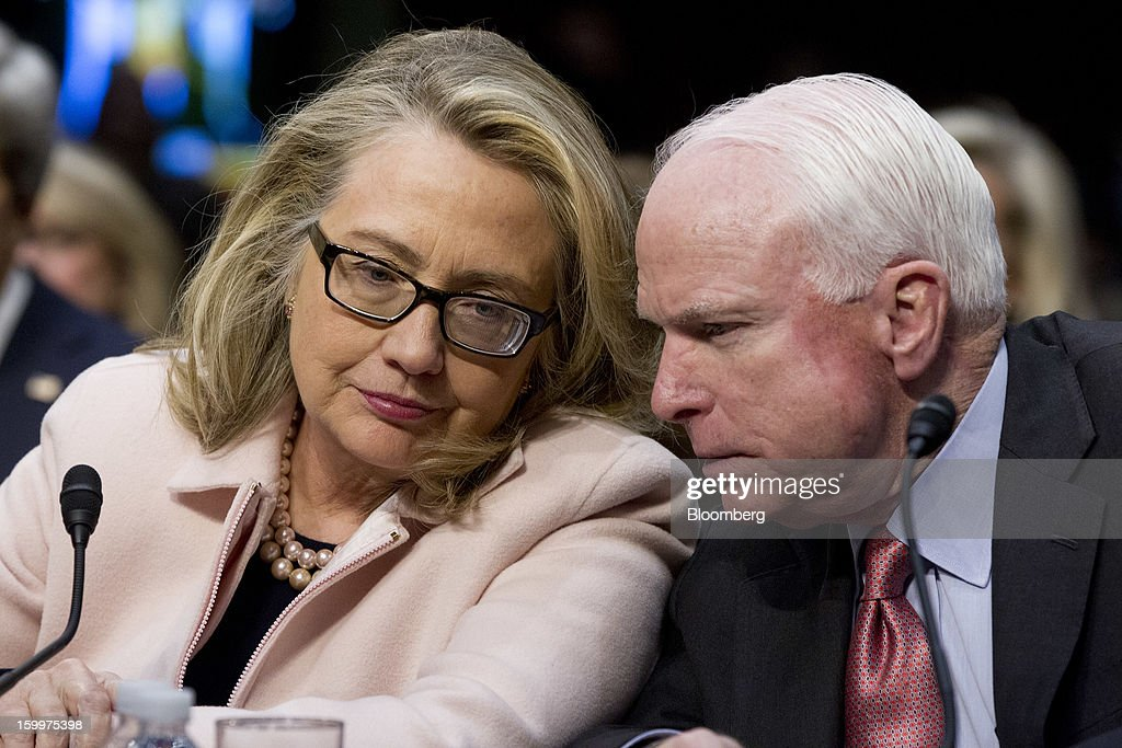 Senator <a gi-track='captionPersonalityLinkClicked' href=/galleries/search?phrase=John+McCain&family=editorial&specificpeople=125177 ng-click='$event.stopPropagation()'>John McCain</a>, a Republican from Arizona, right, and U.S. Secretary of State <a gi-track='captionPersonalityLinkClicked' href=/galleries/search?phrase=Hillary+Clinton&family=editorial&specificpeople=76480 ng-click='$event.stopPropagation()'>Hillary Clinton</a> talk during a Senate Foreign Relations Committee nomination hearing in Washington, D.C., U.S., on Thursday, Jan. 24, 2013. Senator John Kerry stressed the need to prevent Iran from acquiring nuclear weapons. He described the 'immediate, dangerous challenges' facing the nation as he seeks confirmation to become secretary of state. Photographer: Andrew Harrer/Bloomberg via Getty Images