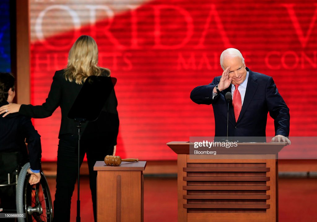 Senator <a gi-track='captionPersonalityLinkClicked' href=/galleries/search?phrase=John+McCain&family=editorial&specificpeople=125177 ng-click='$event.stopPropagation()'>John McCain</a>, a Republican from Arizona, right, salutes while Jeanine McDonnell, daughter of Virginia Governor <a gi-track='captionPersonalityLinkClicked' href=/galleries/search?phrase=Bob+McDonnell&family=editorial&specificpeople=6369061 ng-click='$event.stopPropagation()'>Bob McDonnell</a>, center, and Christopher Devlin-Young, Gold Olympian alpine ski racer, exit the stage at the Republican National Convention (RNC) in Tampa, Florida, U.S., on Wednesday, Aug. 29, 2012. Representative Paul Ryan takes the stage tonight to address the RNC with a dual mission: to provide a spark, along with his big ideas about cutting the budget, to energize the party's base. Photographer: Andrew Harrer/Bloomberg via Getty Images
