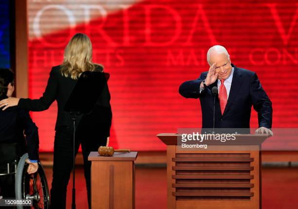 Senator John McCain a Republican from Arizona right salutes while Jeanine McDonnell daughter of Virginia Governor Bob McDonnell center and...