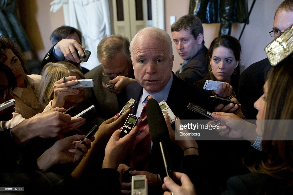 Senator <a gi-track='captionPersonalityLinkClicked' href=/galleries/search?phrase=John+McCain&family=editorial&specificpeople=125177 ng-click='$event.stopPropagation()'>John McCain</a>, a Republican from Arizona, speaks to members of the media about the fiscal crisis negotiations at the U.S. Capitol in Washington, D.C., U.S., on Sunday, Dec. 30, 2012. McCain said his fellow Republicans will stop insisting on using a new inflation measure that would lead to smaller Social Security cost-of-living increases. Photographer: Andrew Harrer/Bloomberg via Getty Images