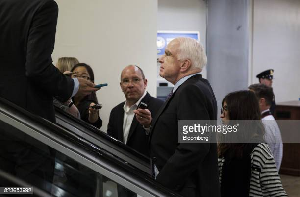 Senator John McCain a Republican from Arizona speaks to members of the media near the Senate Subway in Washington DC US on Thursday July 27 2017...
