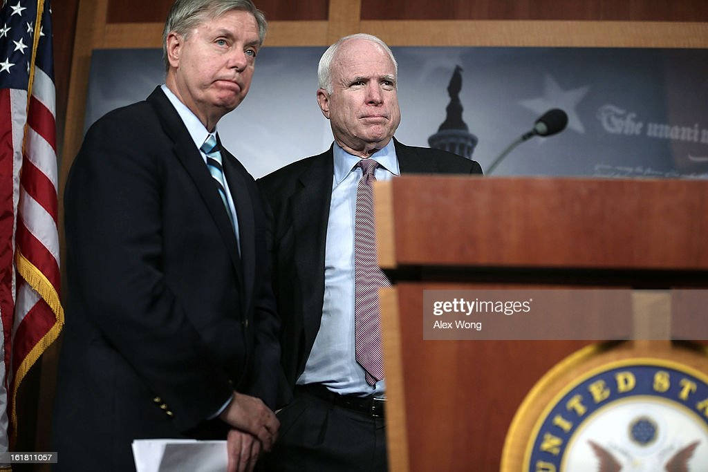 U.S. Senator <a gi-track='captionPersonalityLinkClicked' href=/galleries/search?phrase=John+McCain&family=editorial&specificpeople=125177 ng-click='$event.stopPropagation()'>John McCain</a> (R-AZ) (R), and Senator <a gi-track='captionPersonalityLinkClicked' href=/galleries/search?phrase=Lindsey+Graham&family=editorial&specificpeople=240214 ng-click='$event.stopPropagation()'>Lindsey Graham</a> (R-SC) (L) speak to the press during a news conference on the terror attack that killed four Americans in Benghazi February 14, 2013 on Capitol Hill in Washington, DC. The senators questioned why the Obama Administration did not seek enough help from the Libya government during the attack.