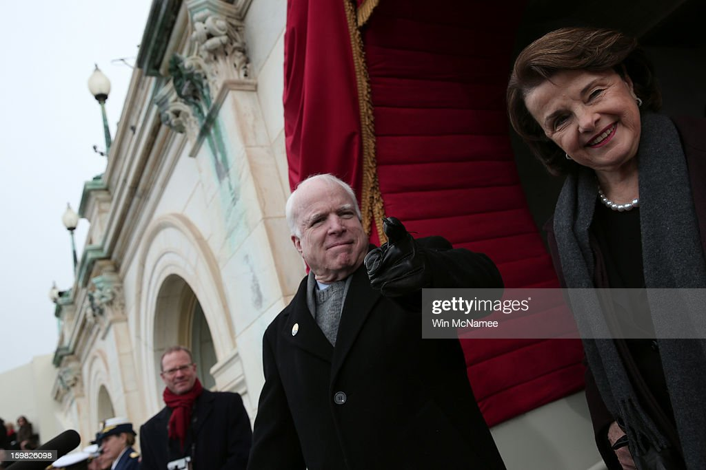 U.S. Senator <a gi-track='captionPersonalityLinkClicked' href=/galleries/search?phrase=John+McCain&family=editorial&specificpeople=125177 ng-click='$event.stopPropagation()'>John McCain</a> (R-AZ) (L) and U.S. Sen. <a gi-track='captionPersonalityLinkClicked' href=/galleries/search?phrase=Dianne+Feinstein&family=editorial&specificpeople=214078 ng-click='$event.stopPropagation()'>Dianne Feinstein</a> (D-CA) gesture to U.S. Rep. Peter King before the presidential inauguration on the West Front of the U.S. Capitol January 21, 2013 in Washington, DC. Barack Obama was re-elected for a second term as President of the United States.