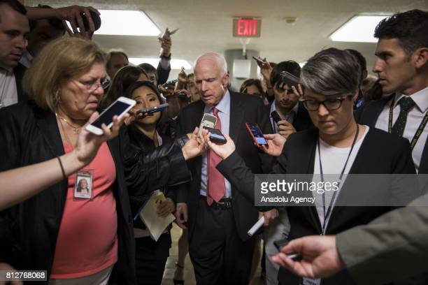 Senator John McCain is surrounded by reporters asking about the state of the Republican Healthcare Bill and recent revelations about Donald Trump...
