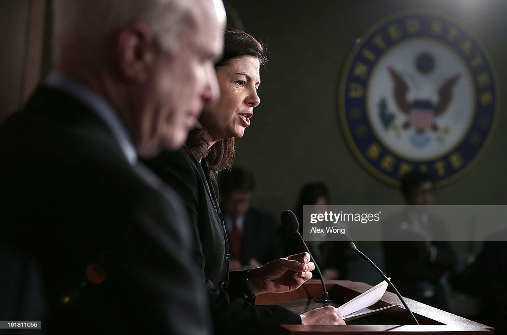 U.S. Senator John McCain (R-AZ) (L) listens as Senator Kelly Ayotte (R-NH) (R) speaks to the press during a news conference on the terror attack that killed four Americans in Benghazi February 14, 2013 on Capitol Hill in Washington, DC. The senators questioned why the Obama Administration did not seek enough help from the Libya government during the attack.